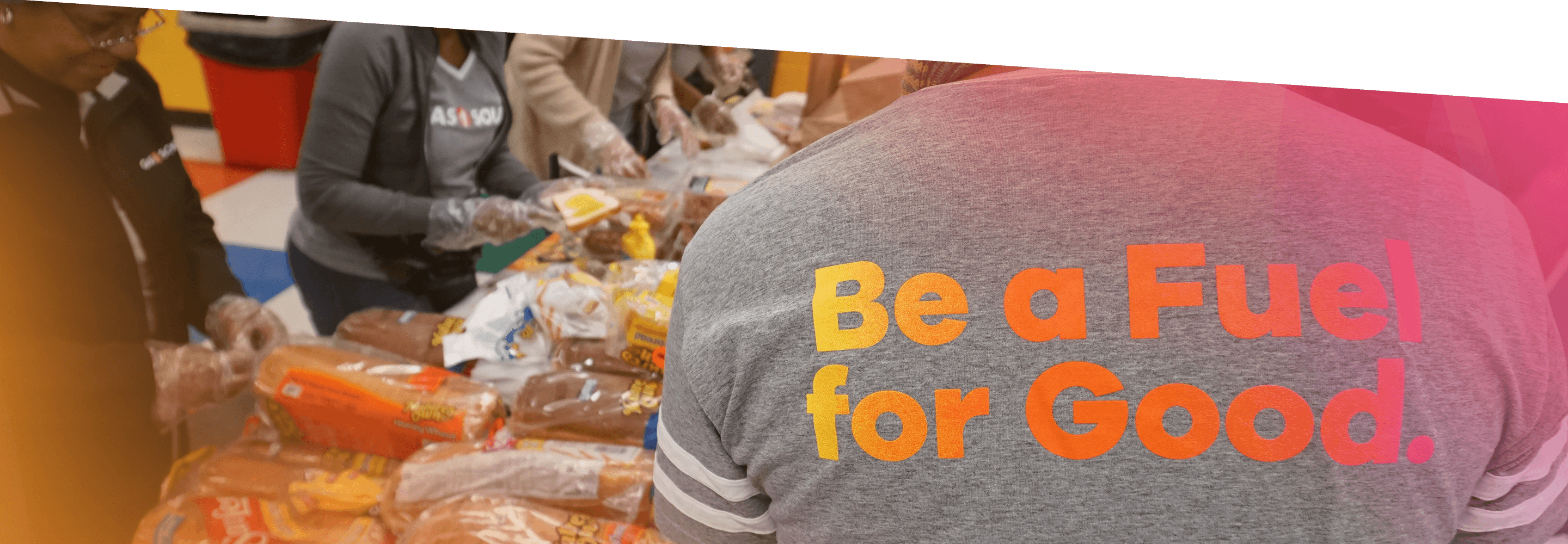 Gas South volunteers help pack school lunches