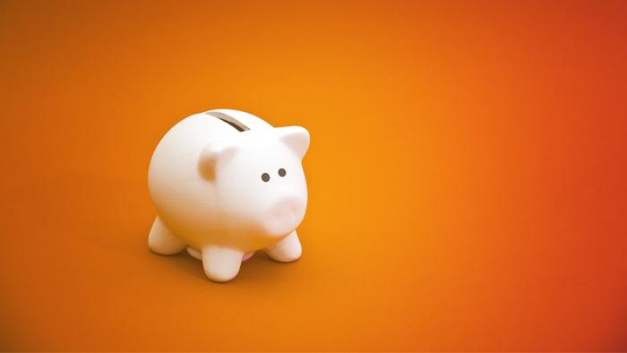 piggy bank against an orange background