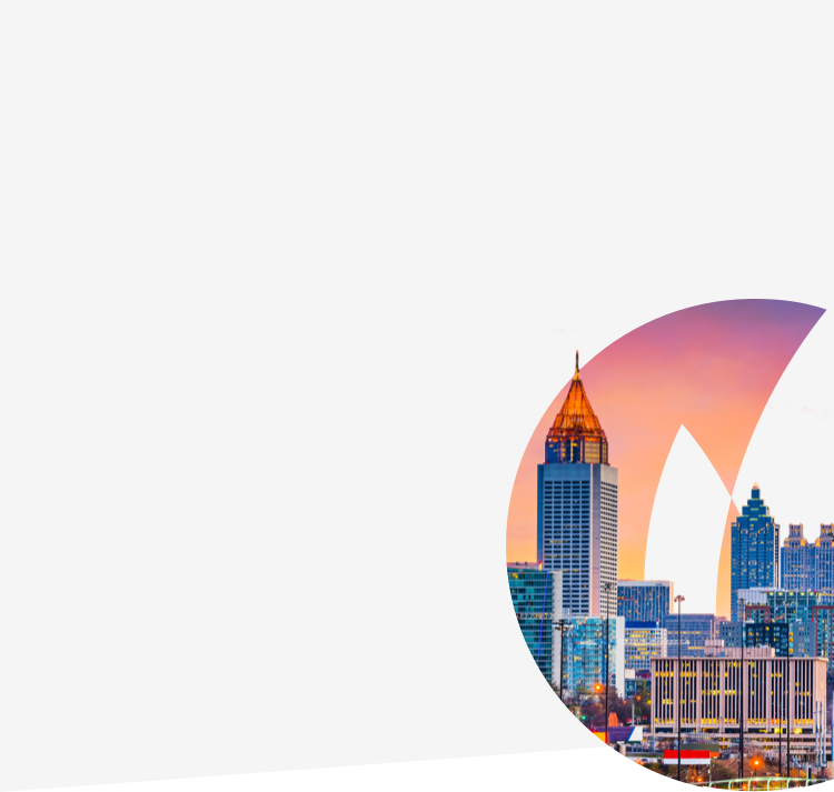 Atlanta city skyline against Gas South logo flame